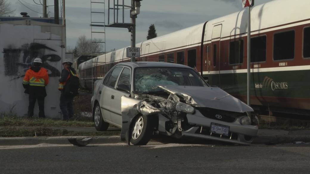 Click to play video: 'Amtrack passenger train hits Vancouver car on tracks'