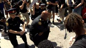 George Floyd protests: Police chief Mark Saunders takes a knee during Toronto rally