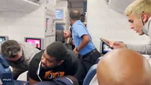 Delta passengers and crew detain 'unruly passenger' during flight to Atlanta (01:03)