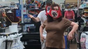 Facebook video shows two Walmart shoppers confronted over wearing swastika masks