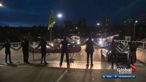 Edmonton reacts after climate protest on Walterdale Bridge