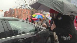 Protesting educators block Ontario education minister's car after anti-bullying announcement