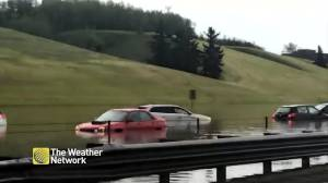 Severe flooding in Calgary leaves cars submerged after storm moves through Alberta (01:06)
