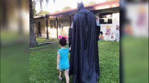 Batman walks bullied three-year-old girl to school so she feels safe
