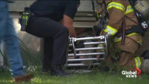 Firefighters rescue two women from basement window in south Edmonton (01:29)