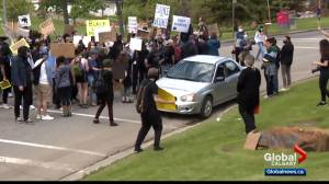 Calgary police investigating possible hate crime after vehicle driven through protest