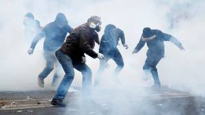 French police fire tear gas at protesters as strike over pension reforms turn violent