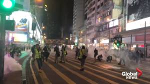 Police fire tear gas as protesters gather in Hong Kong retail district