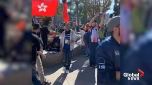 Demonstrators at California gaming convention hand out pro-Hong Kong t-shirts