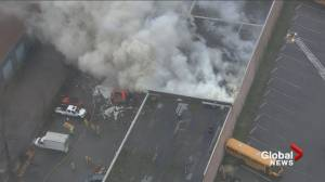 Fire crews in Burnaby battle a three-alarm blaze inside a commercial building