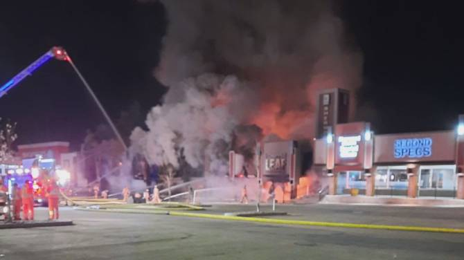 Click to play video: One person arrested after an overnight fire destroyed several businesses in Sherwood Park