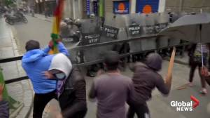 Bolivia protests: Striking workers clash with police over controversial health emergency law (02:14)