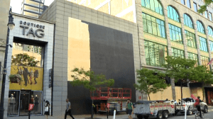 Downtown Montreal stores board up windows after police notice