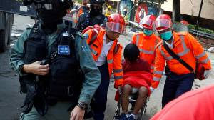 Hong Kong first aid brings out injured protesters from university as schools reopen (02:31)
