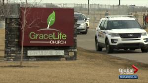 Crowd gathers outside fenced off GraceLife Church near Edmonton (02:21)