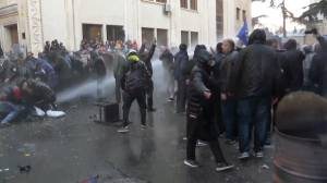 Georgia police use water cannons, tear gas in attempt to force back protesters outside parliament