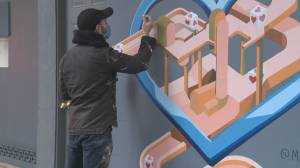 Boarded-up businesses become canvases for artists (01:56)
