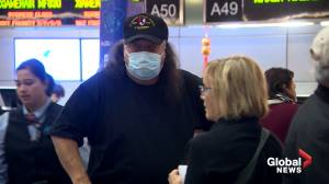 Travelers in U.S. don face masks to protest against novel corona virus, though officials say risk of illness in country low