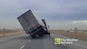 High winds cause semi truck to tip over in southern Alberta (00:45)