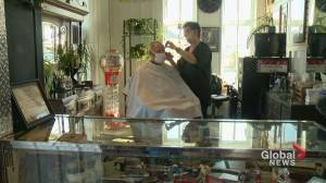 COVID-19 pivot: barber opens shop in 'world's largest man cave' (01:41)