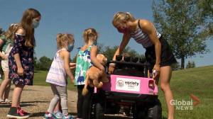 Regina twins living with cerebral palsy receive adapted toy car