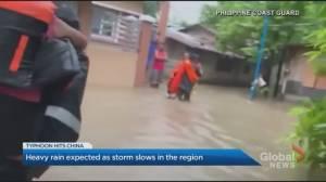 Typhoon In-fa hits China, heavy rain expected as storm slows (01:43)