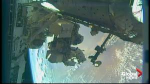 Astronauts begin spacewalk to install docking adapter at space station