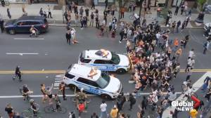 George Floyd death: Video appears to show NYPD vehicles drive into protesters