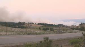 Nk'Mip Creek Wildfire moves into Oliver neighborhood (01:46)