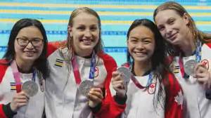 Team Canada wins Olympic silver in women's synchronized diving, freestyle relay (01:49)