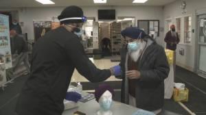 Calgary volunteers help Sikh seniors accommodate religious wear and masks (01:45)