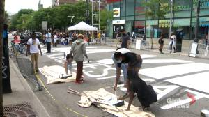 Black Lives Matter artwork painted on street block in Montreal's east end