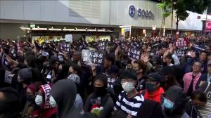 As government urges calm, Hong Kong protesters march once more (00:52)
