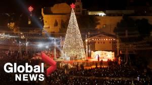 Hundreds gather for Christmas tree lighting ceremony in Bethlehem to mark start of festive season
