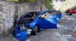Car slams into stone wall north of Grafton