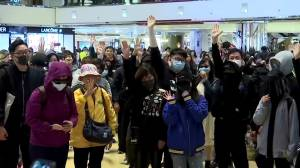 Hong Kong police scuffle with protesters at mall amid Christmas shoppers