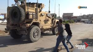 U.S. military vehicles pelted with stones, rotten fruit amid Syria withdrawal
