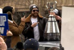 Fans line the streets of downtown Winnipeg for the Grey Cup parade