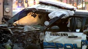 Bystander saves officer from burning car