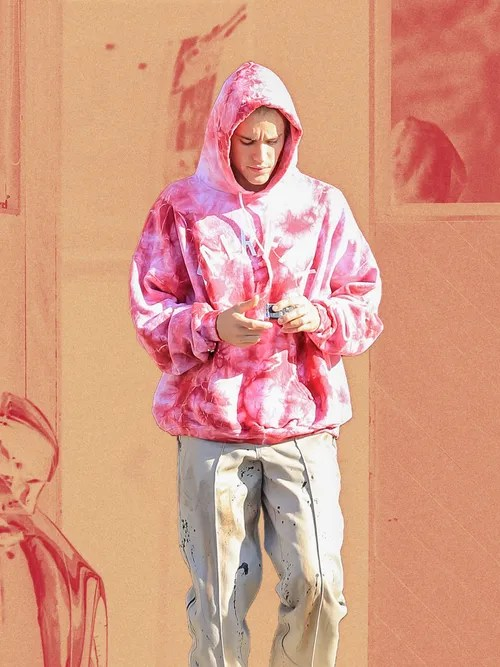 Justin Bieber in chino pants and tie dye hoodie