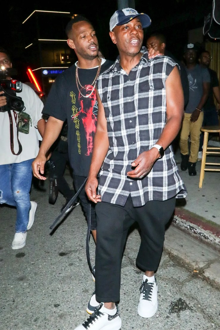 Image may contain Marlon Wayans Clothing Shoe Footwear Apparel Human Person Pants Denim and Jeans