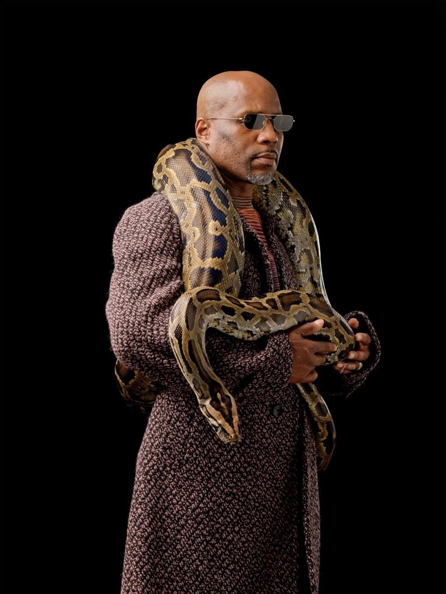dmx holding a snake around his neck