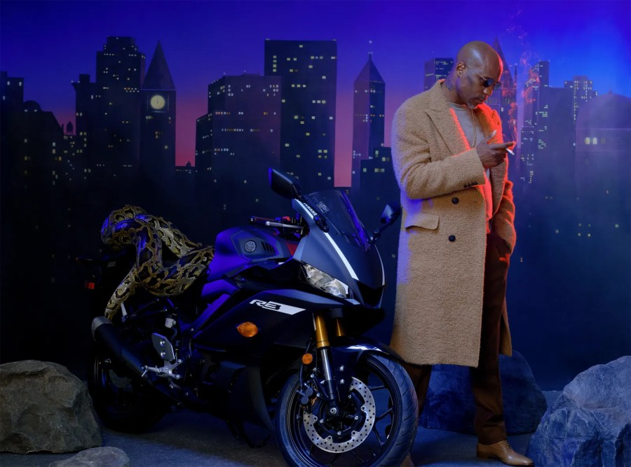 dmx smoking a cigarette next to a motorcycle