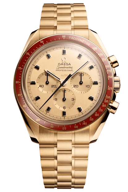 A gold watch with a red dial and gold face
