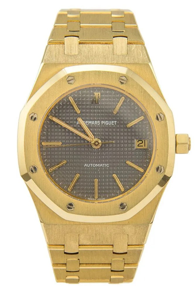 A gold watch with a grey face