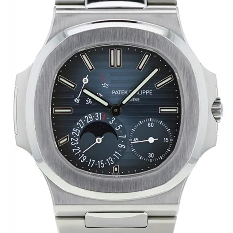 A steel watch with a blue face