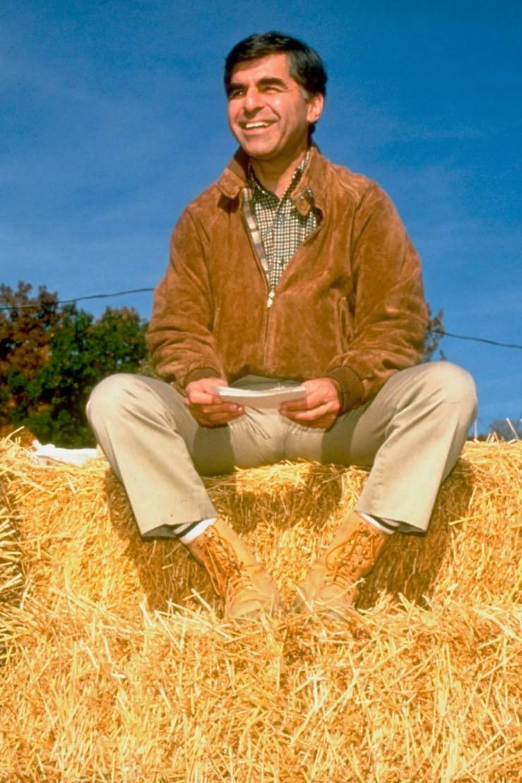 Image may contain Michael Dukakis Outdoors Clothing Apparel Nature Human Person Plant Countryside Harvest and Hay