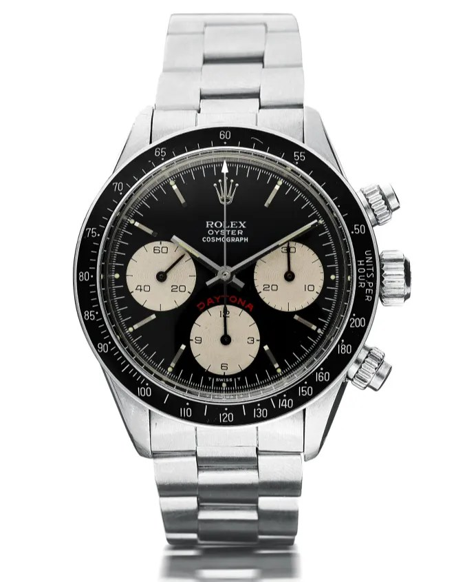 A silver watch with a black bezel black face and white subdials