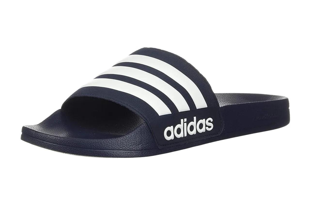 Image may contain: Clothing, Apparel, Footwear, Flip-Flop, Cap, Baseball Cap, Hat, and Sandal