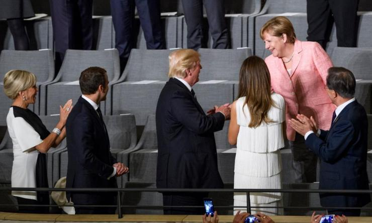 Brigitte and Emmanuel Macron, Donald and Melania Trump, Angela Merkel and Moon Jae-in.